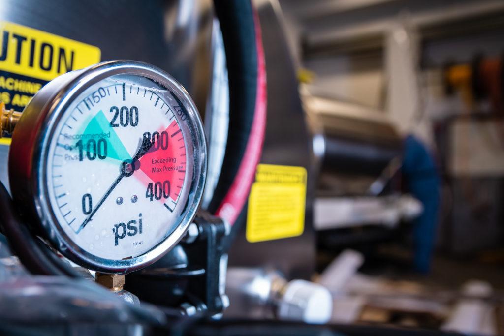 Photo of Turbo-mist agricultural sprayer pressure gauge.
